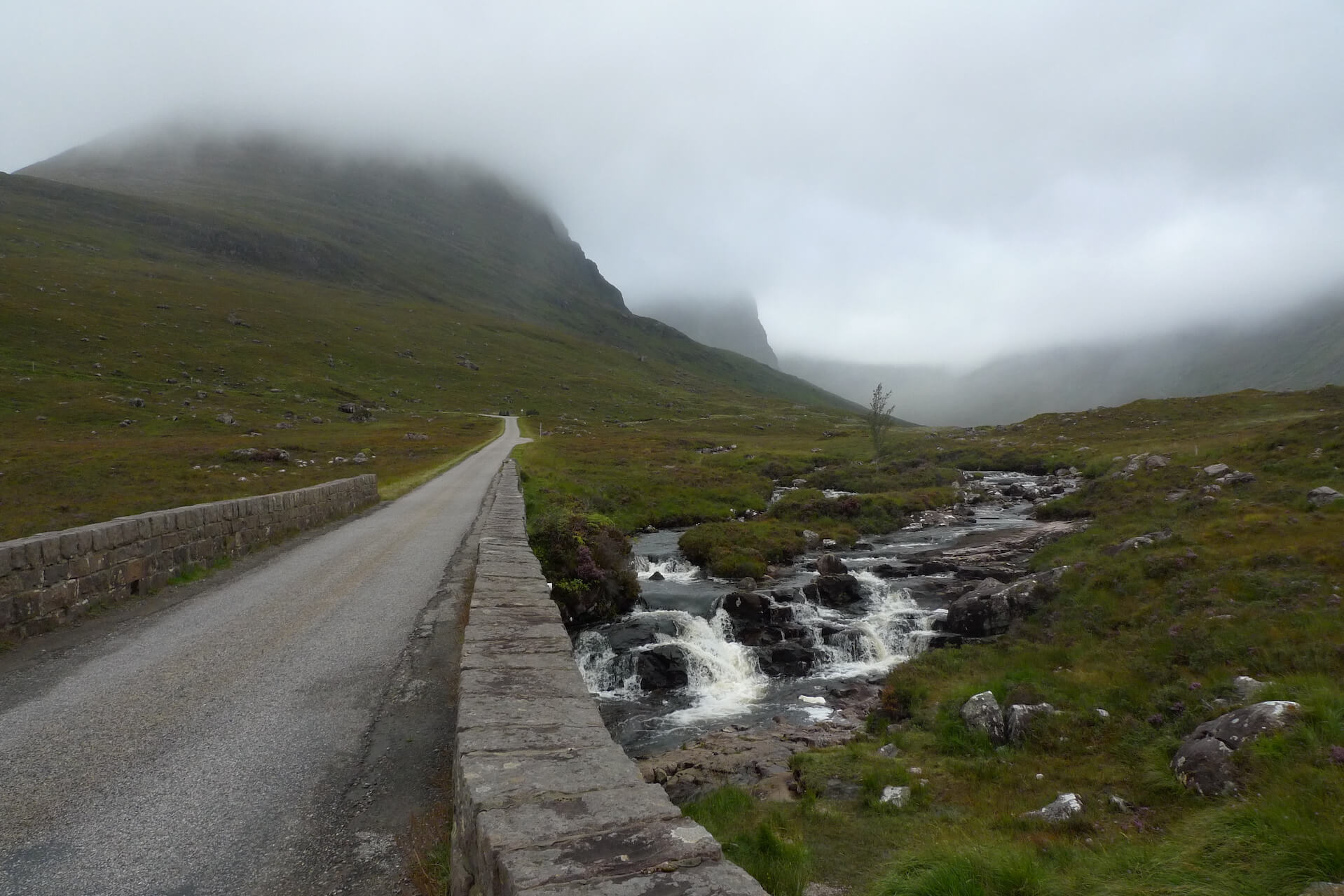 Mist in the hills as seen from the foot of the Bealach na Bá