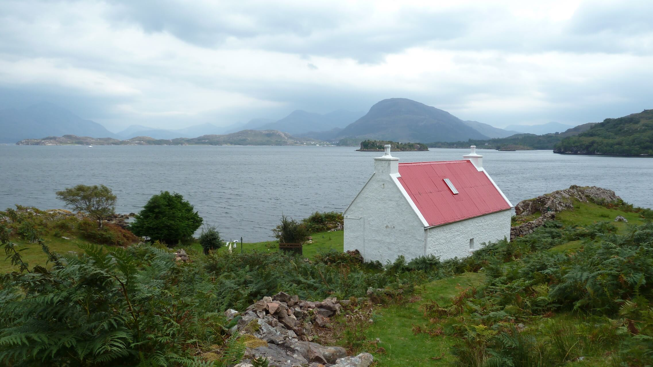 Picturesque Red Roof Cottage, often photographed by tourists, Ardheslaig, Applecross Peninsula