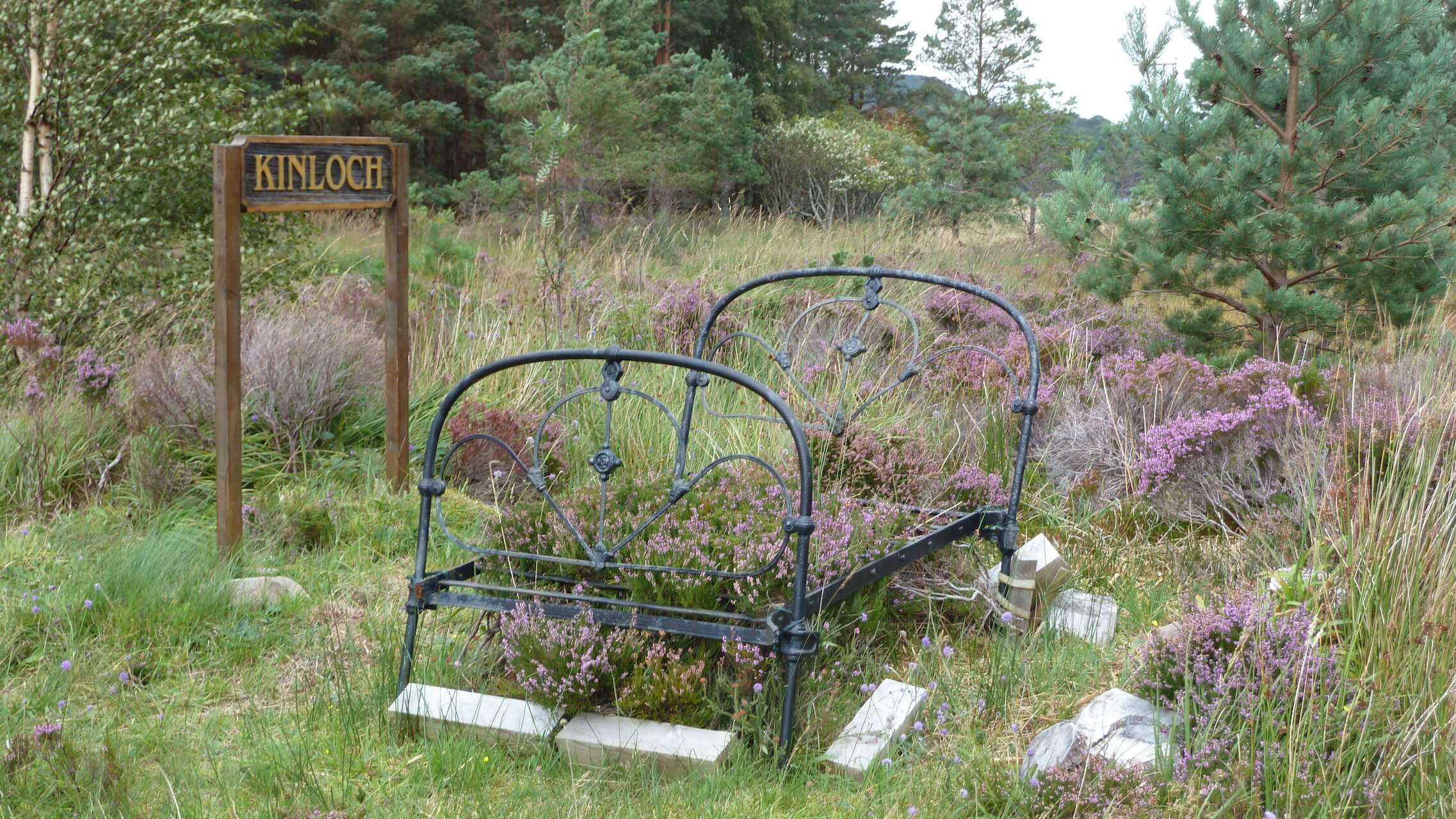 Abandoned old-fashioned iron bedframe overtaken by the heather, Applecross Peninsula