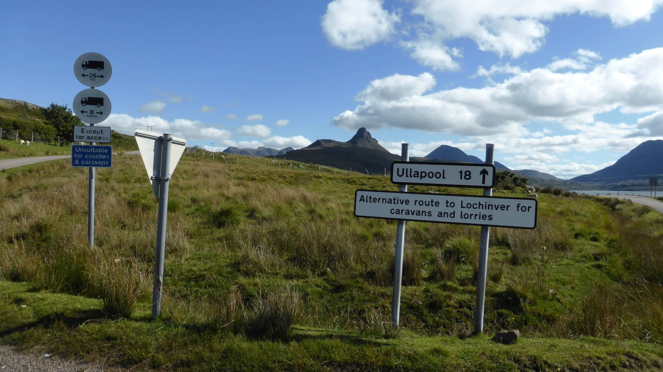 Signpost for Ullapool with Stac Pollaidh in the background