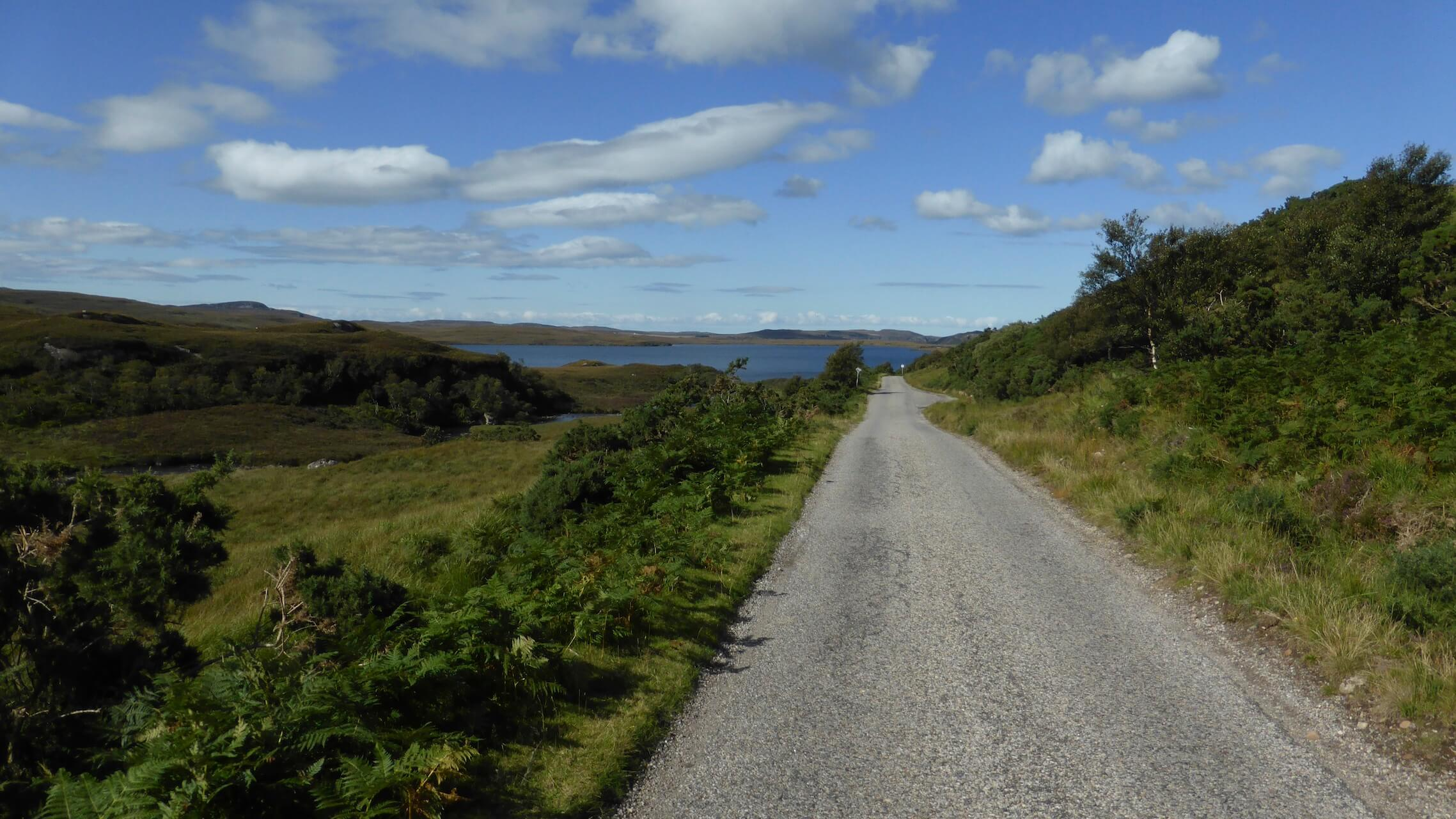 A straight single track road leads to the sea near Achiltibuie