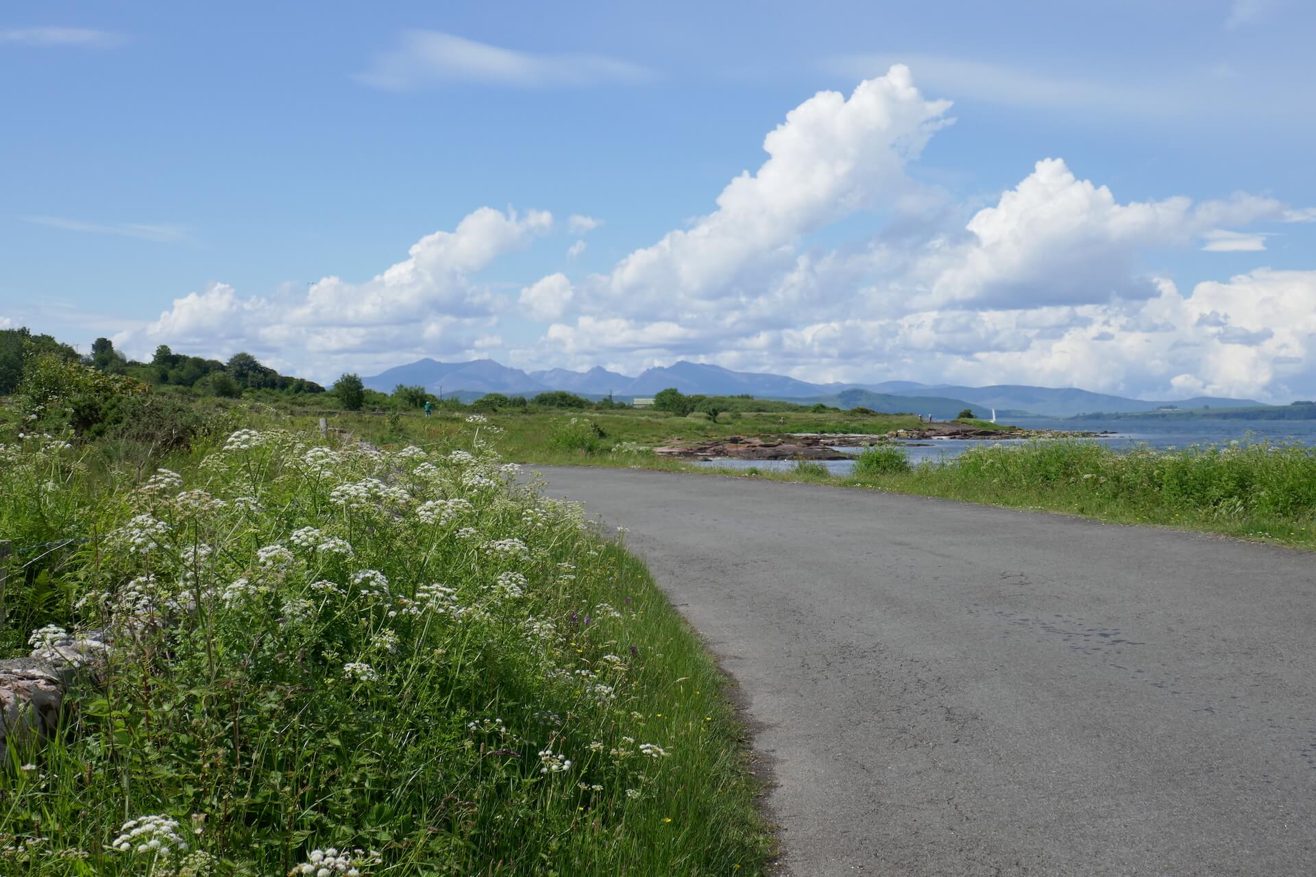 Cumbrae coastal road with view of the mountains of Arran in the distance